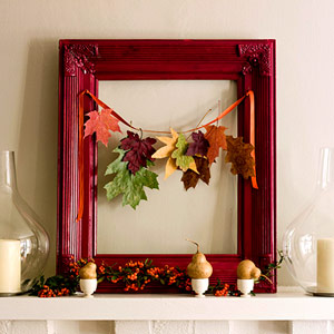 a bold red picture frame with a garland of colorful fall leaves, berries and pears in egg holders