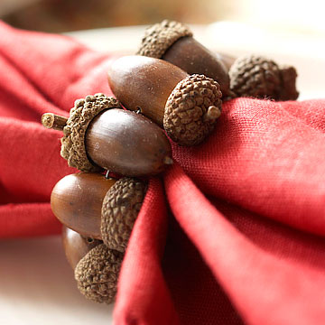 a red napkin with an acorn napkin ring is a bold accessory for your fall tablescape