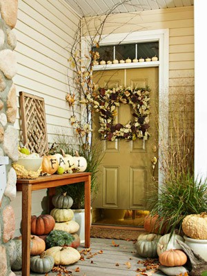 There are plenty of ways to display pumpkins on your porch and here a lot of them are used at once. At least 30 of them are used here.