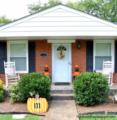 Your porch's could be quite minimal. A small wreath and tiered pumpkins is more than enough.