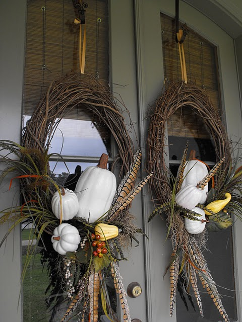 Adding pumpkins on a wreath is a perfect idea if you don't want to occupy any floor space.