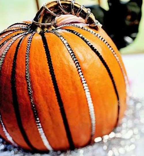 a glam pumpkin with sequin ribbons is a lovely decoration for the fall and it looks bright and fun