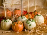 white and orange cake pops are perfect for a fall wedding dessert table, they bring the spirit