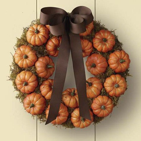 it's so amazing to take a couple of real pumpkins from your veggie garden and attach them to the wreath form. Although you could use faux pumpkins too.