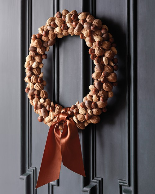 For this natural harvest wreath simply attach acorns or nuts to a grapevine wreath using a glue gun. Although make sure you have at least 100-200 of them before starting the project.