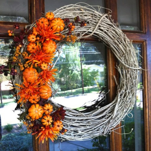 Spray paint a twig wreath in white and add an orange color splash to it using pumpkins and fall blooms. You've got yourself a stylish wreath!