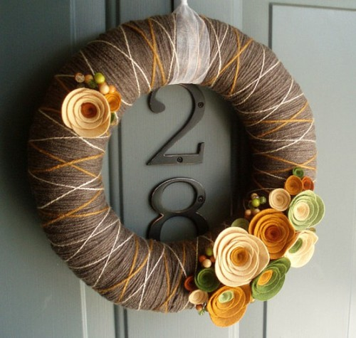 The cool thing about simple wreaths is that you can change floral embellishments  according to the season.