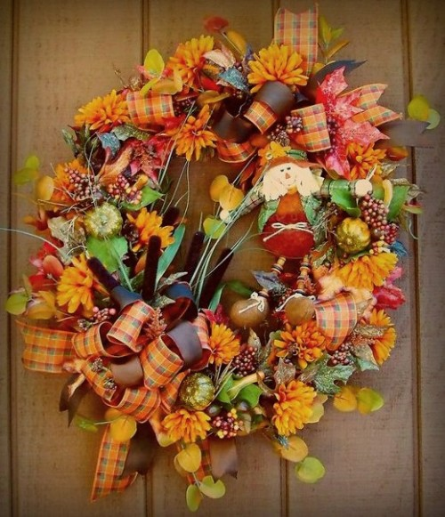 By mixing colorful ribbon with fall blooms you can get yourself a vibrant arrangement to hang on a front door.