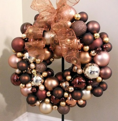 If you want some Christmas spirit early, make a wreath from Christmas tree's ornaments but in fall's colors.