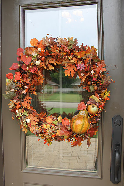 Autumn's blooms, leaves and gourds is an ultimate combo to make a wreath. Just make sure to apply a coat or two of spray lacquer.