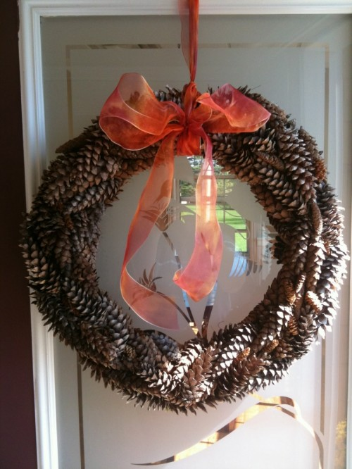 The cool thing about pinecone wreaths that you can use them as for fall as for winter.