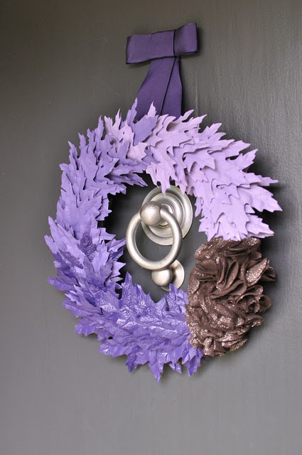 Purple spray paint is a quite unusual choice to upgrade a traditional fallen leaves wreath. Although you can go with any color you like...
