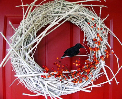 Add a tiny crow silhouette to your wreath for an easy transition to Halloween.
