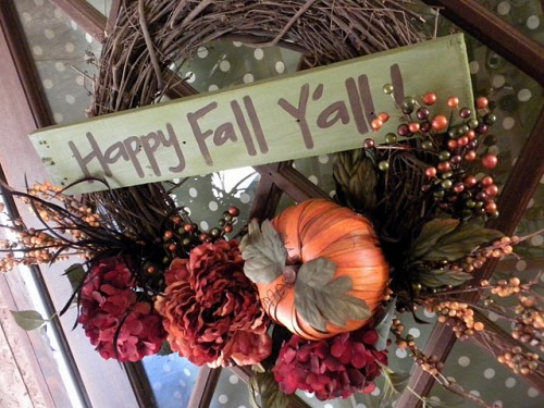 Add a small rustic sign to your wreath to spell out a cute fall greeting.