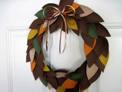 Sketch out a leaf pattern and use it to cut a  bunch of leaves from stiff craft felt. Fix them on a wreath form using hot glue and welcome your guests with style.