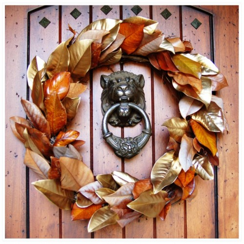 Spray paint several faux leaves with metallic paint and add to your wreath to make it shine.