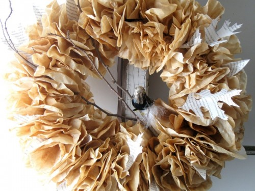 Loops and layers of  fabric and paper can turn an ordinary wreath into a multi-dimensional piece of decor.