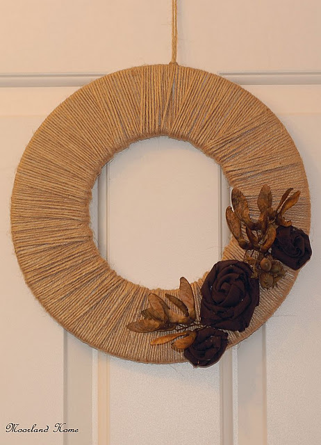 Cover a wreath form with twine and add some dried leaves to make a rustic arrangement for your front door.