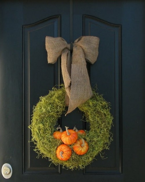 Dried moss creates a beautiful backdrop for orange accents.