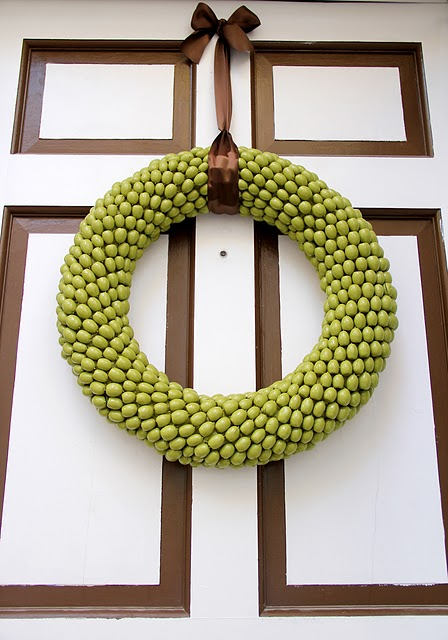 To make your nut wreath shine simply spray paint it into some bright color.