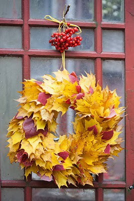 Gather fallen leaves, and cut a small hole  each of them. String the leaves onto a store-bought wire wreath frame until the frame is hidden. Use a yellow yarn to hang the wreath you made.