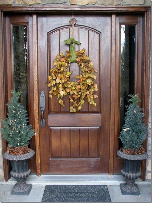 Gather a bunch of long twigs with leaves on them, tie them together and hand on a front door for a last-minute wreath.