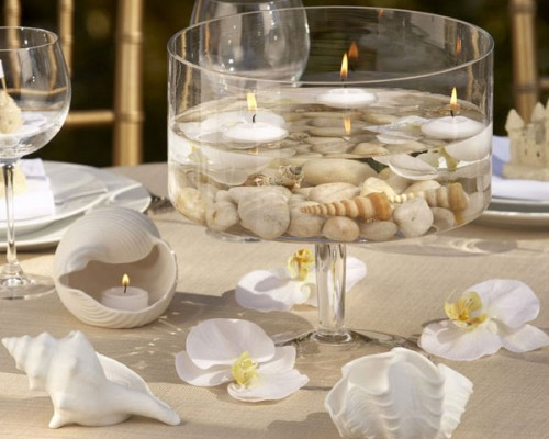 Floating candles looks great with pebbles and sea shells. So eco!