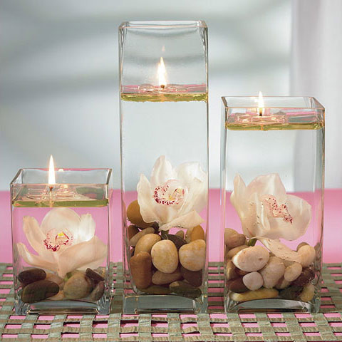 Vases filled with water and pebbles look great with underwater flowers and candles on top