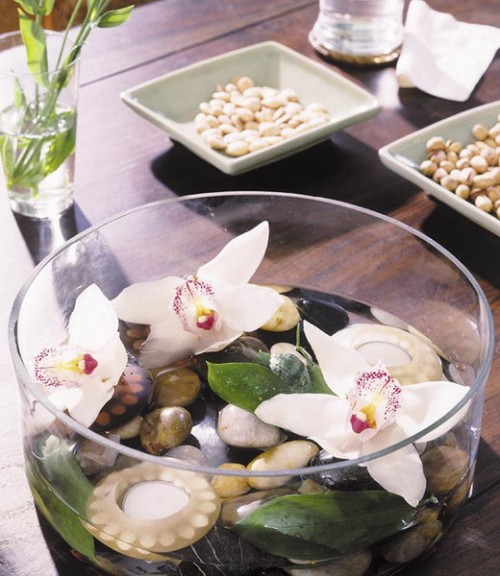 Pebbles, orchids and candles are a perfext mix