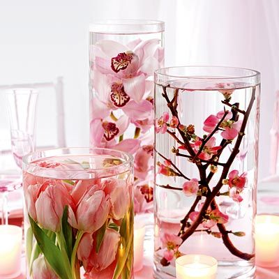 Vases are perfect containers to put full flower branches in them. Besides, submerged orchids looks great!