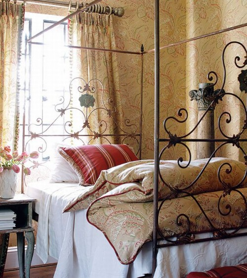 wrought iron headboard is a must for a french country bedroom