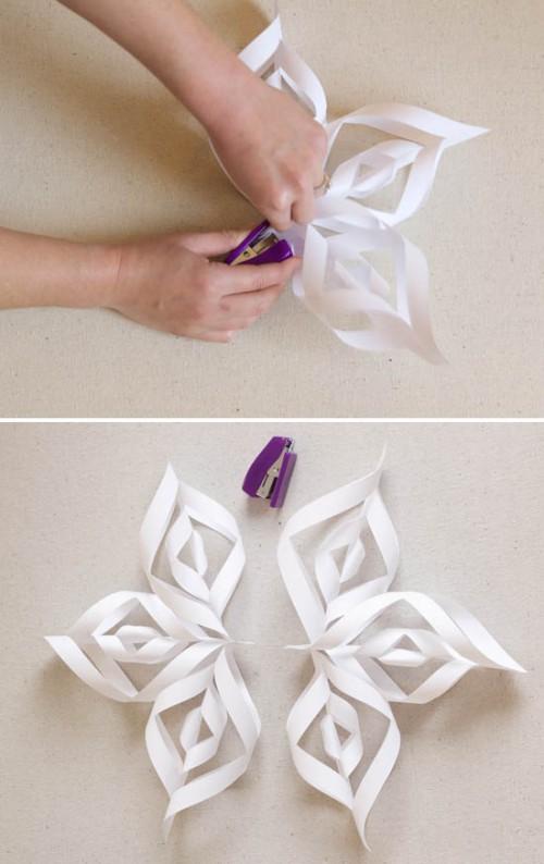3D paper snowflakes (via athomeinlove)