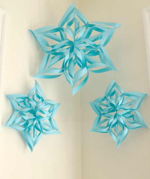 colorful paper snowflakes (via ladyfaceblog)
