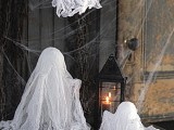 ghosts made of cheesecloth are amazing to decorate the space for Halloween and they are very easy to DIY anytime