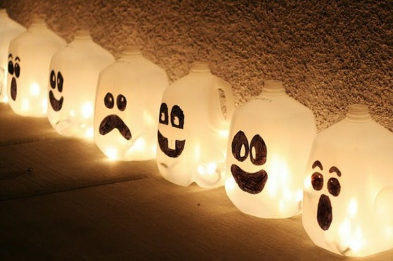 mini ghosts made of milk bottles are creative and fun decorations for a kid Halloween party