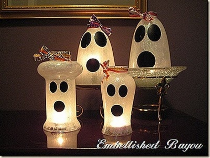 cloche and lamps styled as ghosts are scary and chic kid party decorations you can DIY