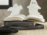 paper ghosts cna be made fast and attached anywhere you want to add a Halloween feel to the space