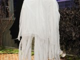 a cheesecloth ghost can be hung outdoors or indoors and it's very easy to craft anytime