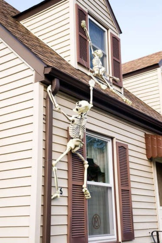 skeletons climbing up the wall can be a nice outdoor or indoor decoration that is very easy to install