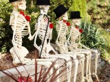 skeletons in top hats are an elegant decoration for outdoors or indoors, and they are easy to make