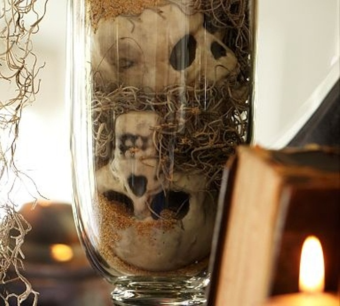 a glass with skeletons and hay is a simple and scary decoration to use for Halloween