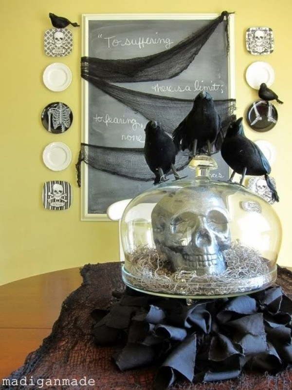 a cloche with a skull and hat plus blackbirds on top is a stylish Halloween decoration