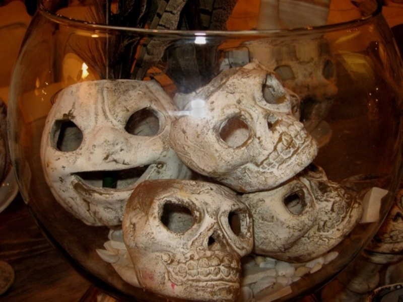 an aquarium with skulls is a stylish Halloween decoration that can be DIYed for cheap