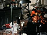 a black stand with skulls, blackbirds, ornaments and a witch hat on top is a stylish idea for Halloween