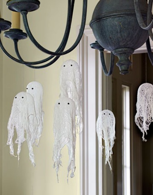 hang some cheesecloth ghosts on a chandelier to make the space look spooky enough but not too much