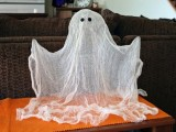 a cheesecloth ghost like this one is a nice and easy to make decoration for an adult or kid Halloween party