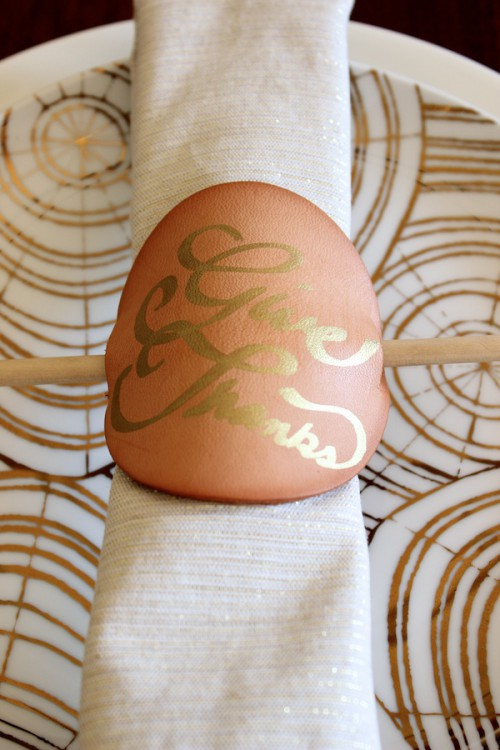 leather and gold napkin rings (via fabricpaperglue)