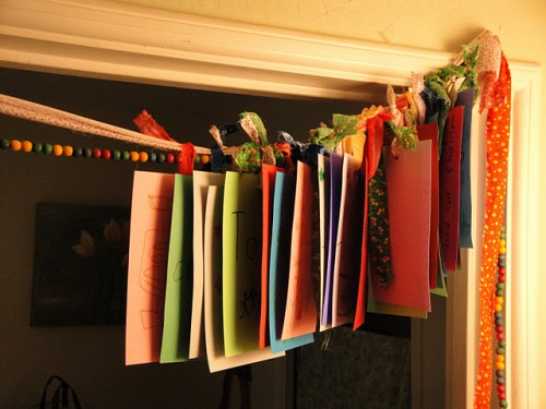 a gratitude garland made of bright papers with wishes is always a good idea for Thanksgiving and you can make it easily
