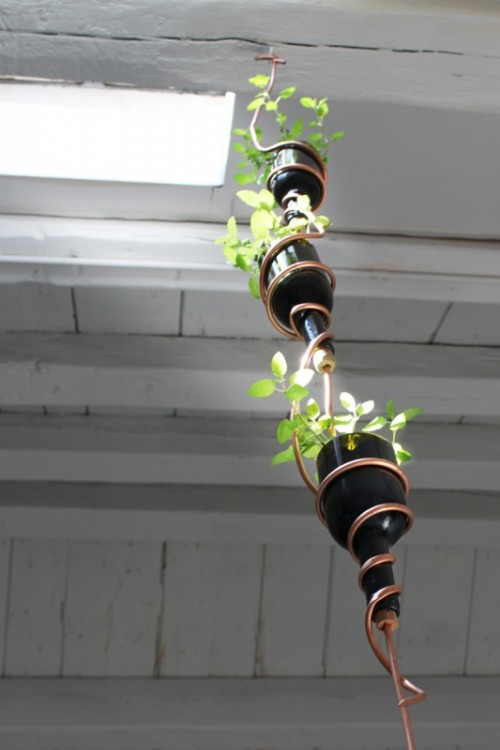 reused wine bottle herb planter (via shelterness)