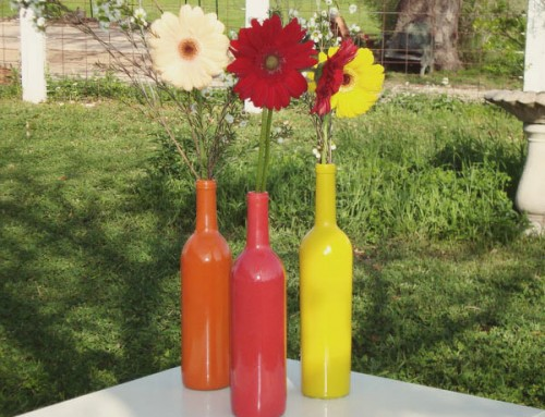 colorful wine bottle centerpiece (via shelterness)